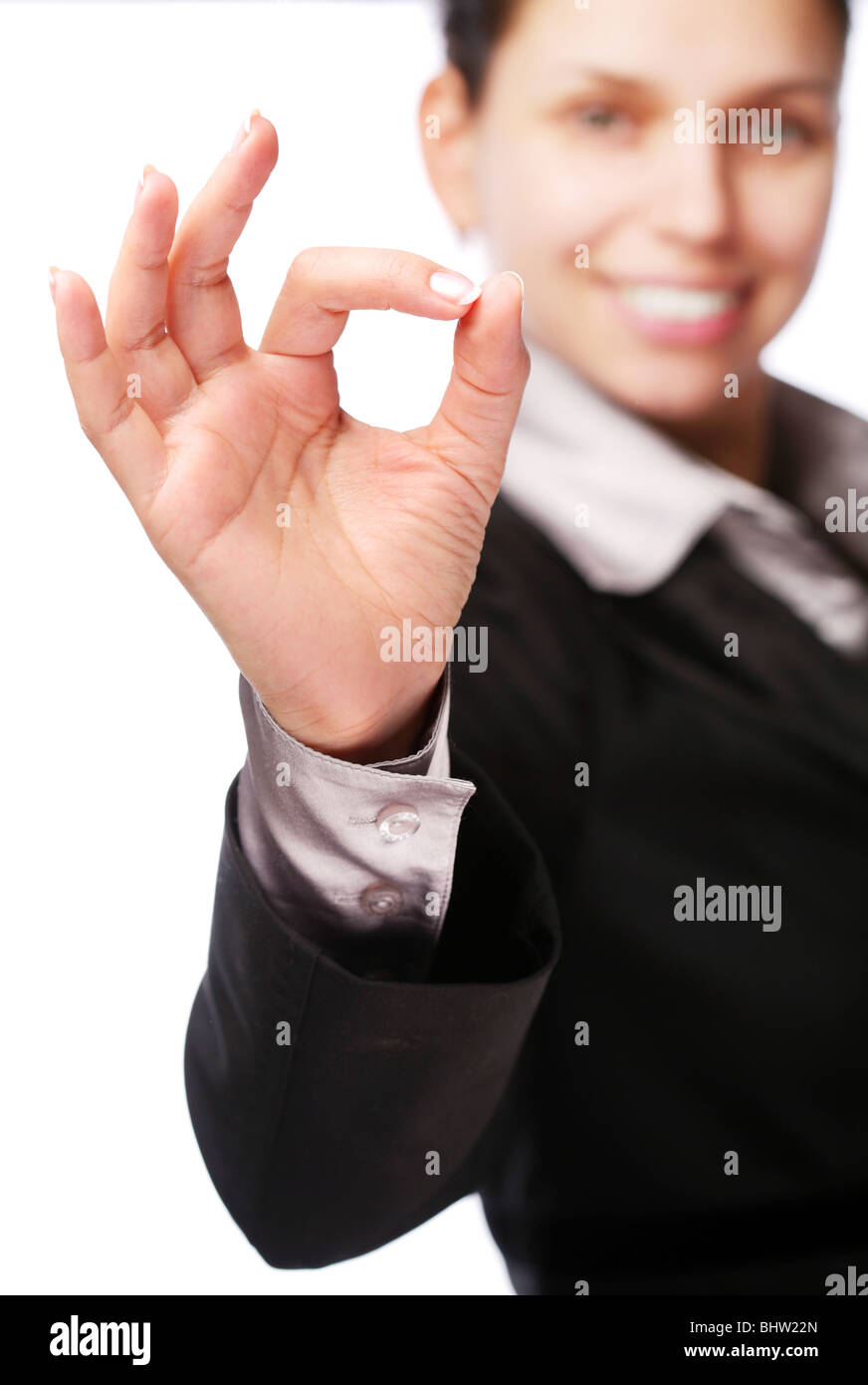 Business woman makes sign 'Ok' by hand. Isolated on a white - Stock Image