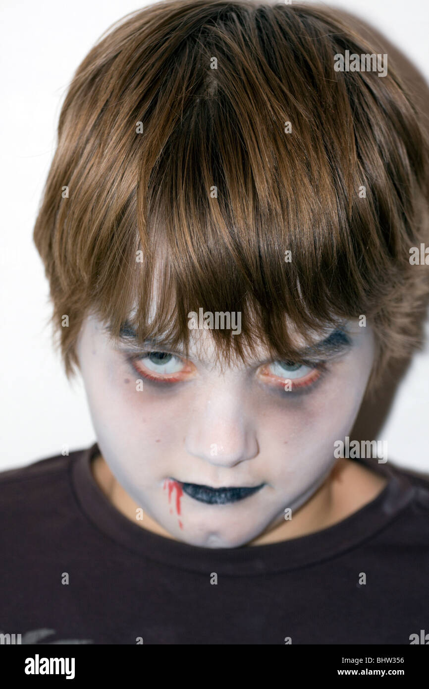 Teenage boy with scary facepaint. - Stock Image