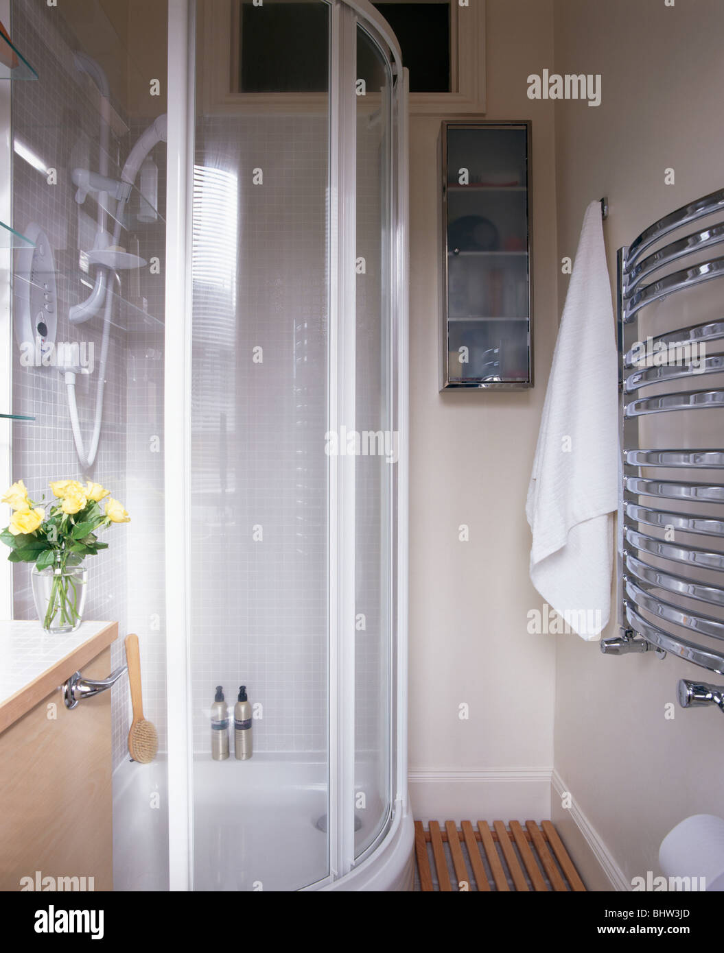 Glass shower cabinet in small modern white bathroom with wall ...