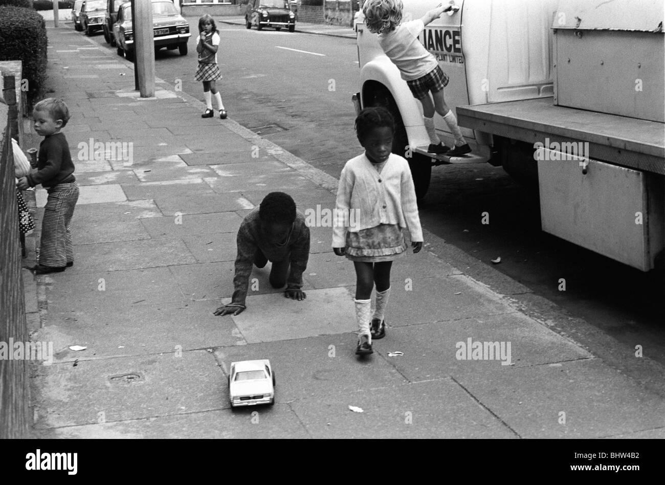 Kids playing in street south London UK 1975 HOMER SYKES - Stock Image
