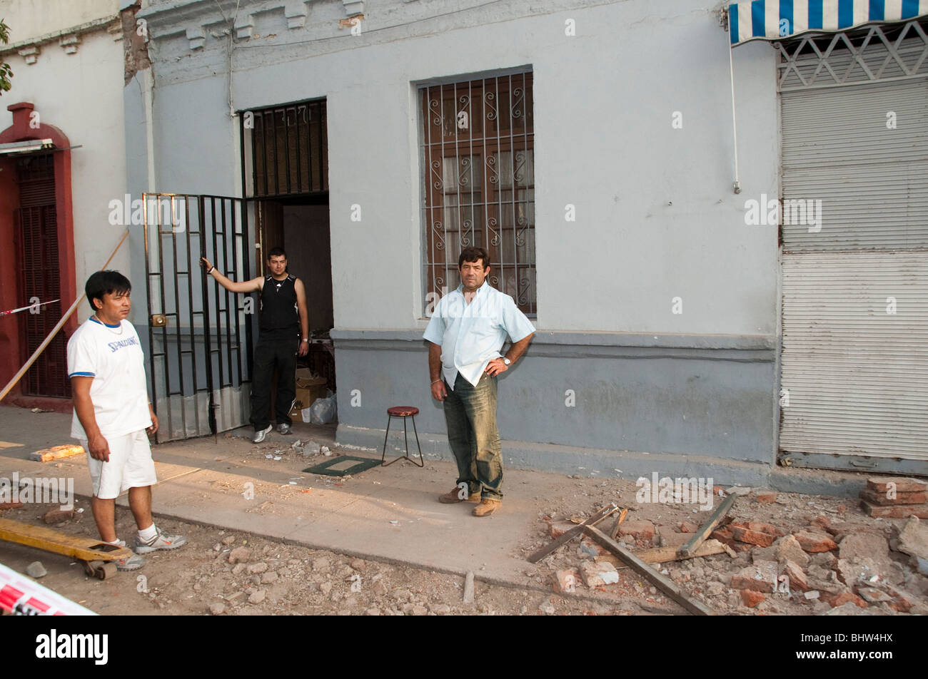 A Family who has to evacuate its rented home after the Earthquake destroyed the Adobe Walls. The roof is coming - Stock Image