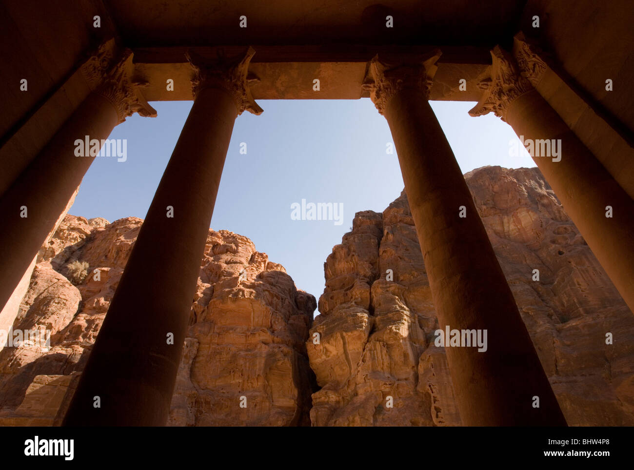 View of columns from inside the Treasury or Al Khaznah looking towards the Al Siq canyon in the ancient city of - Stock Image