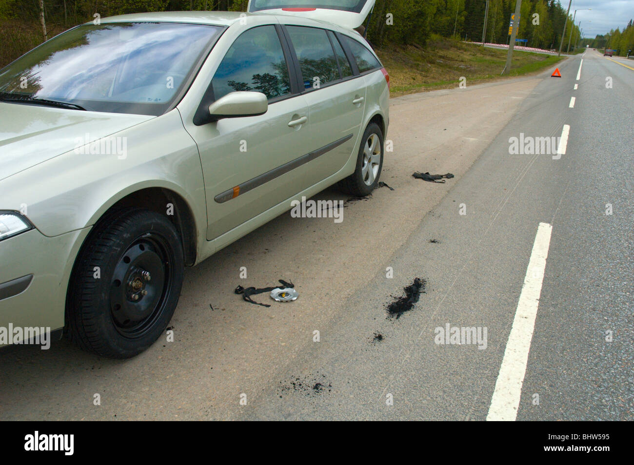 Car with a spare tyre changed after a puncture Finland Europe - Stock Image