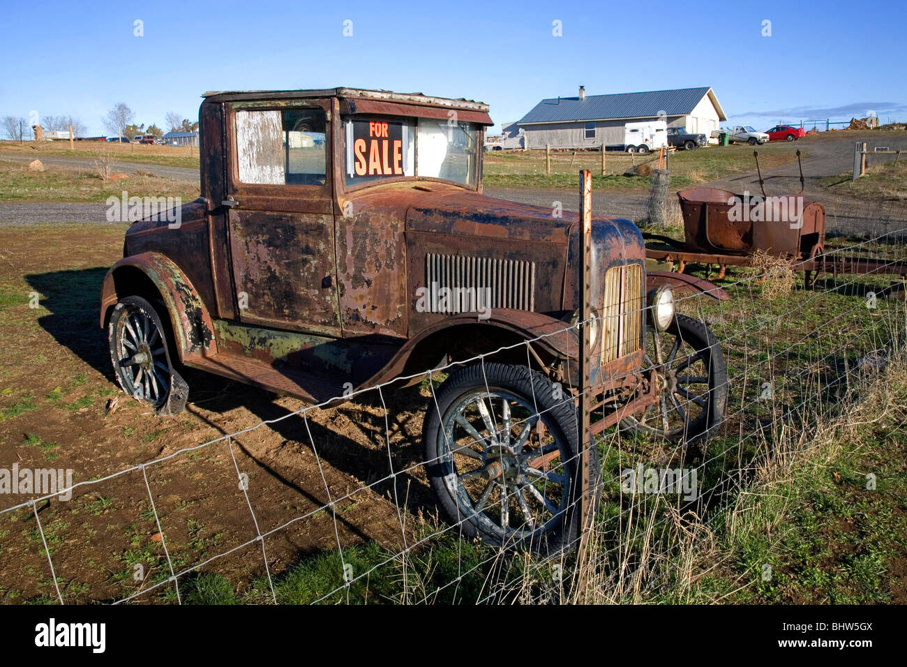 Old Antique Cars For Sale >> A For Sale sign on an ancient rusted classic car in a field near Stock Photo: 28212714 - Alamy