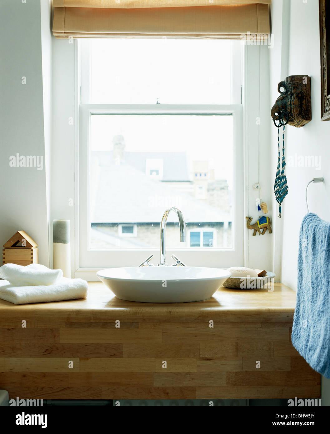 Modern White Bowl Basin On Wooden Vanity Unit Below Window In Small Stock Photo Alamy