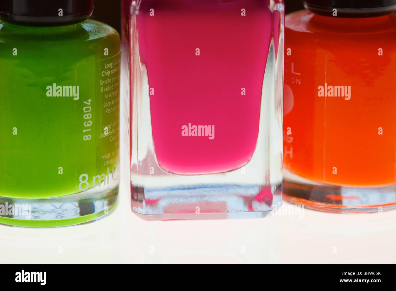 nail varnish bottles close up using a macro lens and lightbox - Stock Image