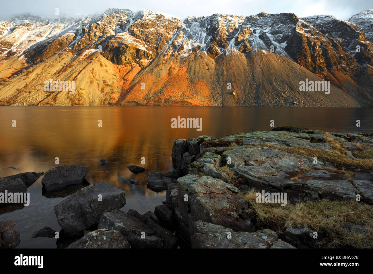 Wast Water screes, the top dusted with snow, English Lake District - Stock Image