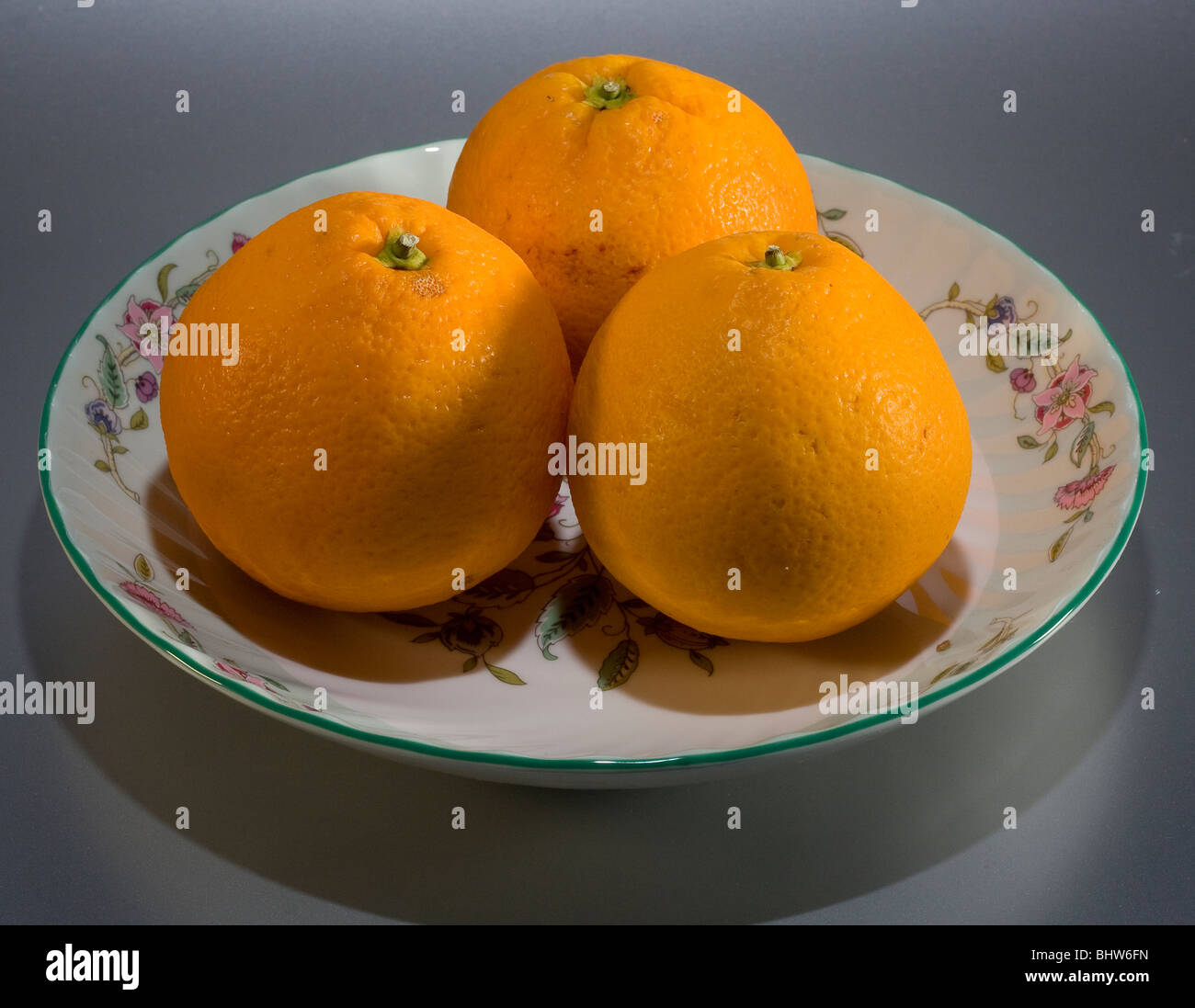 Bowl with oranges - still life - Stock Image