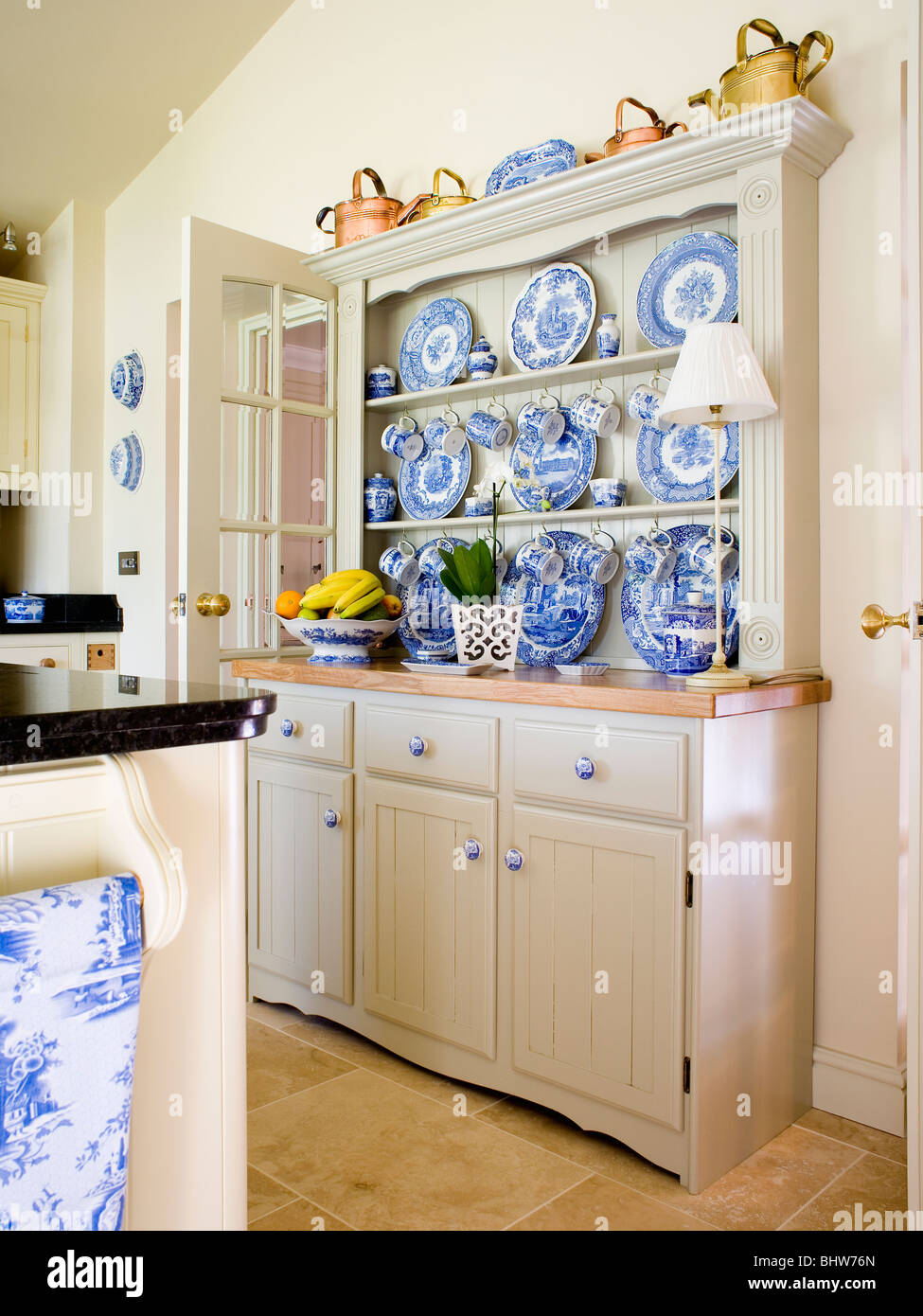 Collection Of Blue White China On Fitted Cream Dresser In