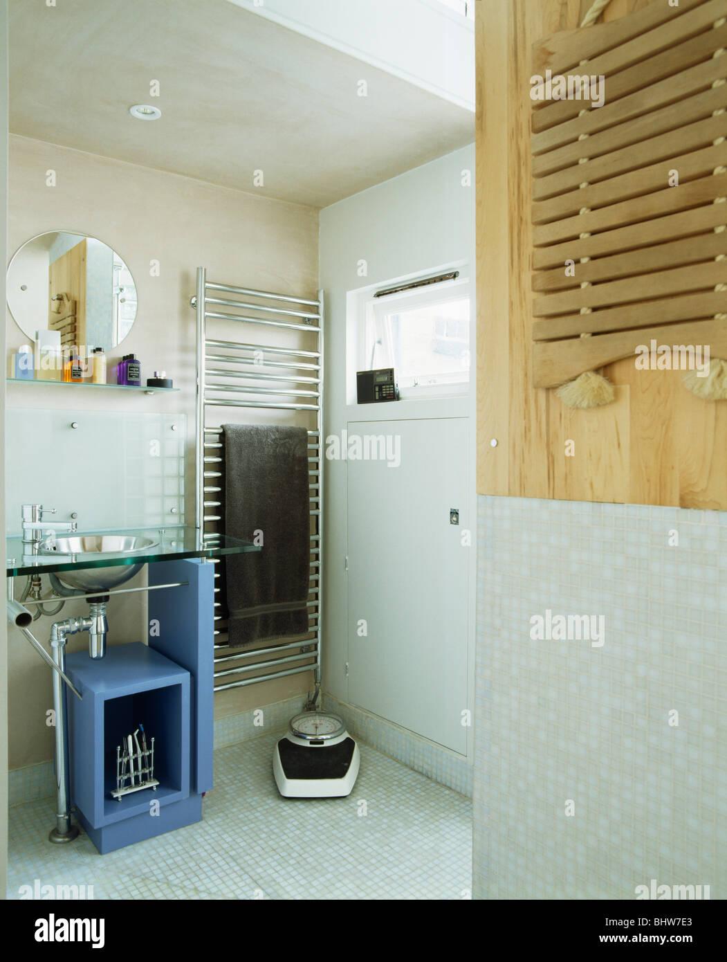Blue Shelf Unit Below Glass And Basin In Small Modern White Bathroom Stock Photo Alamy