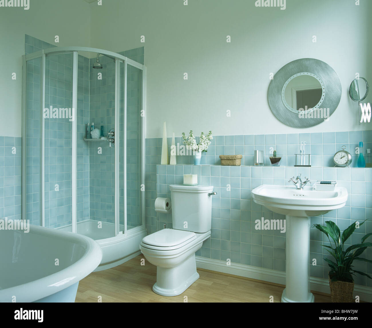 Shower cabinet with glass doors in corner of bathroom with pastel ...