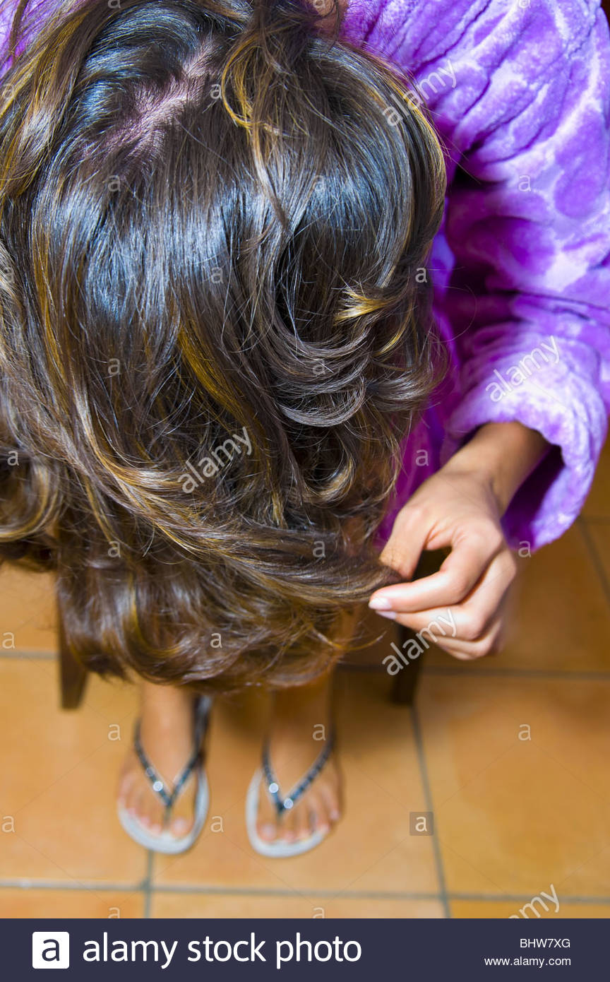 Woman getting her hair done - Stock Image