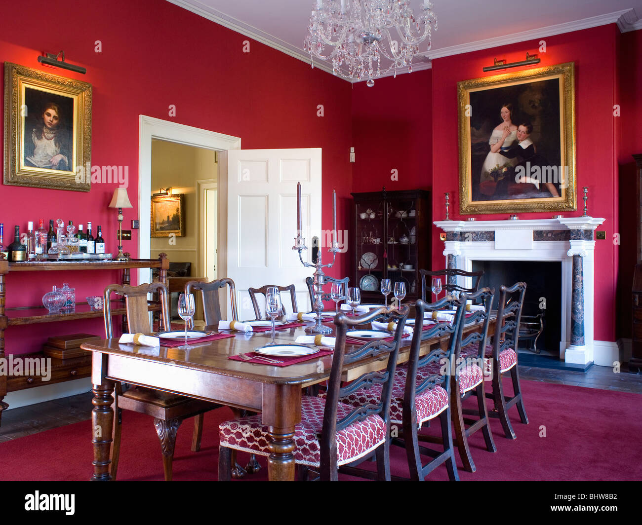 Picture of: Antique Mahogany Table And Chairs In Red Dining Room With Lighting Stock Photo Alamy