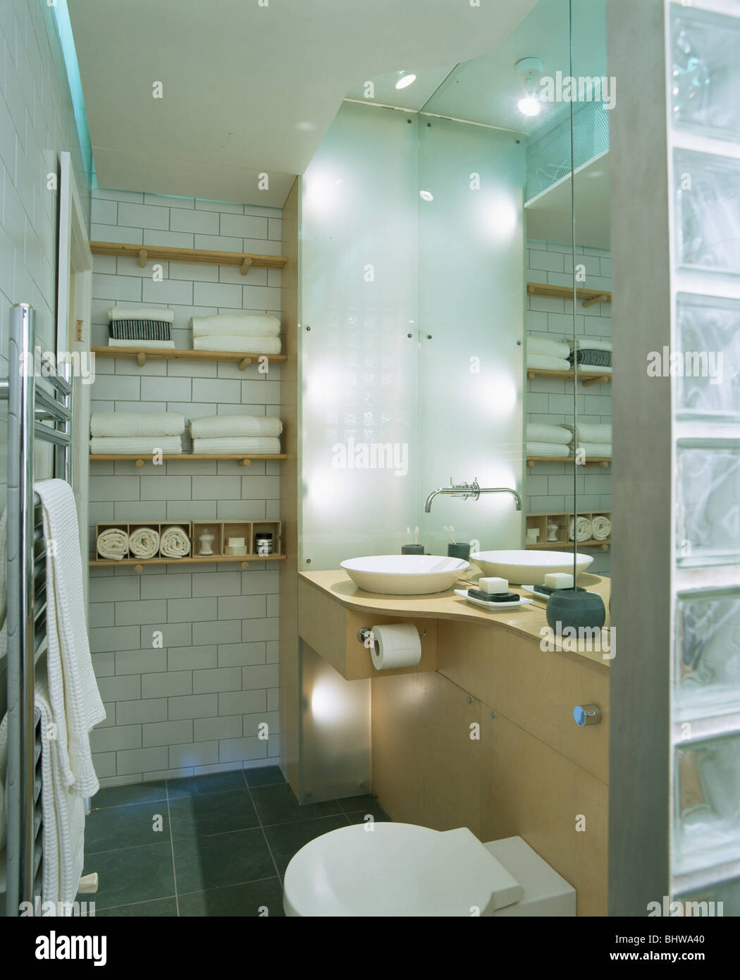 Recessed lighting in modern bathroom with towels stored on Stock ...