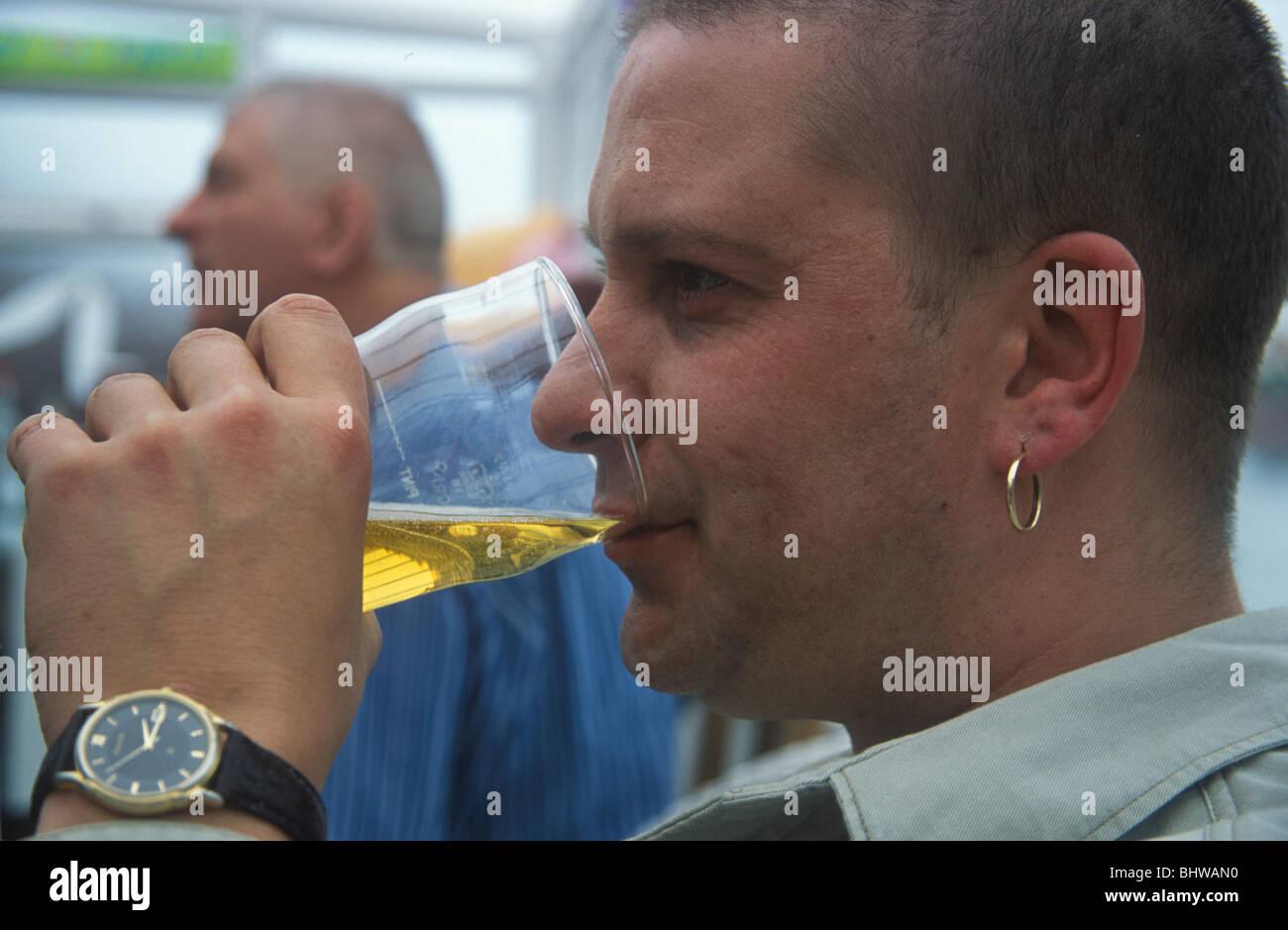 man drinking lager - Stock Image