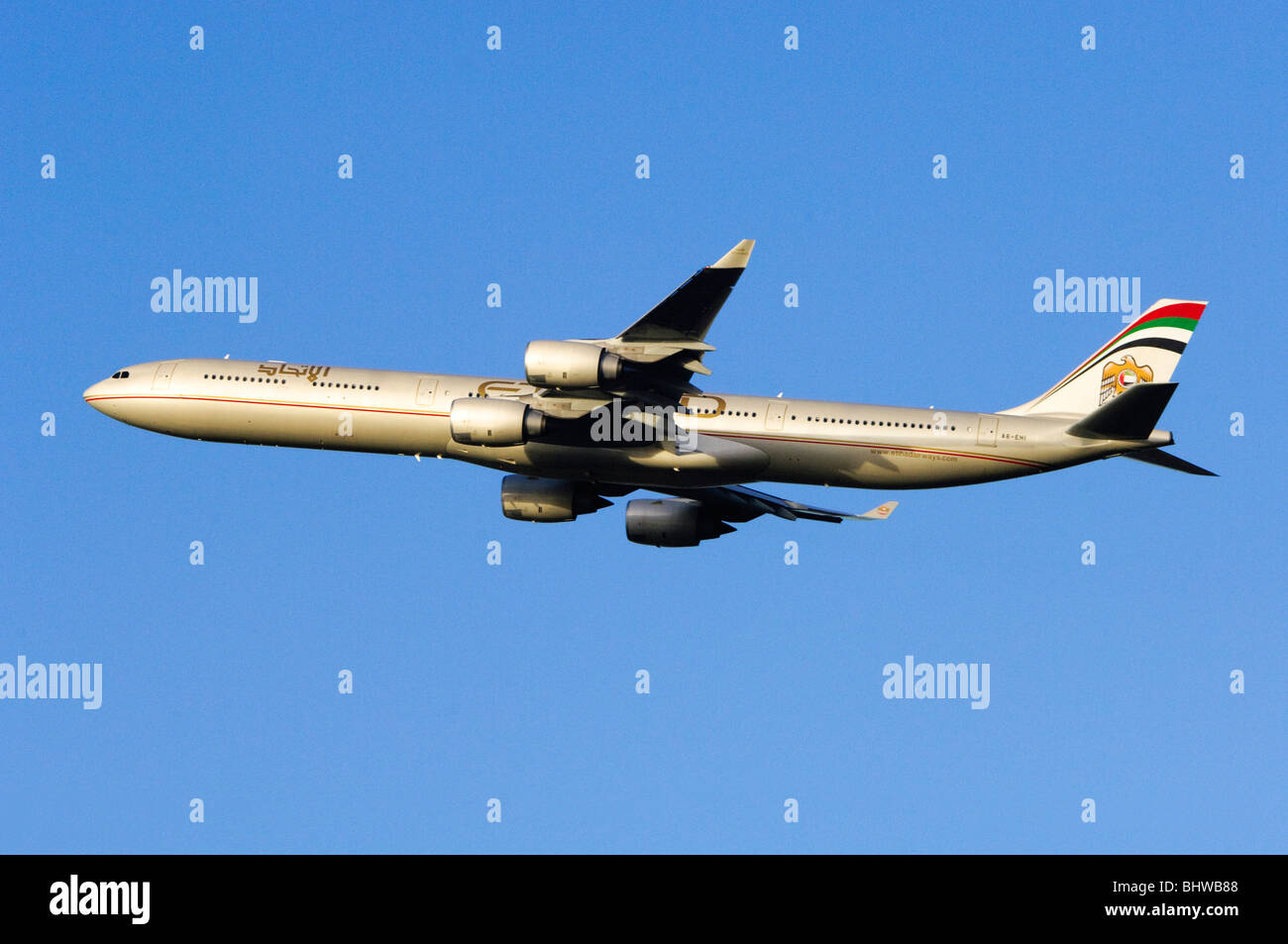 Airbus A340 operated by Etihad Airways climbing out after take off from London Heathrow Airport - Stock Image