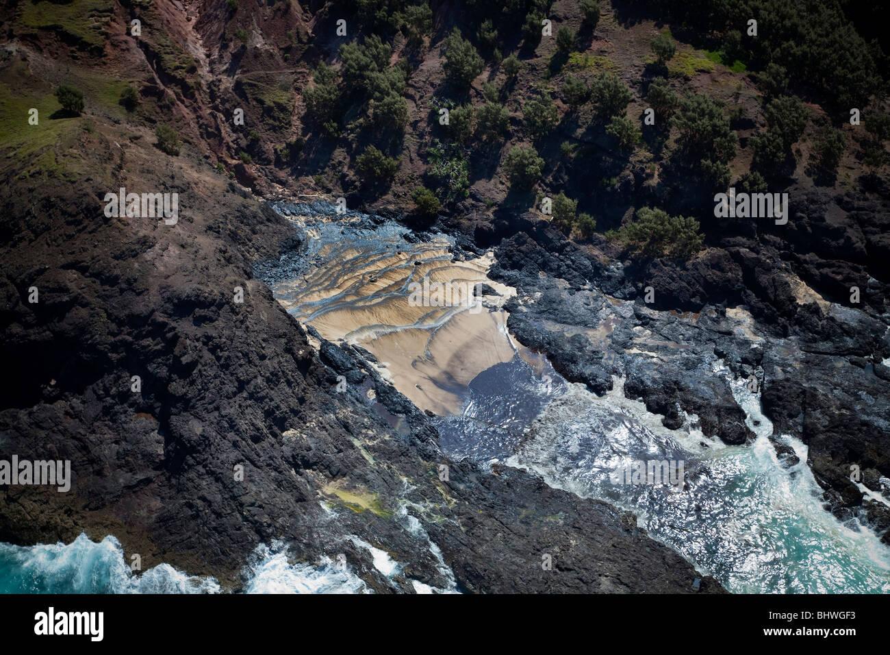 Oil spill washing up on coastline Moreton Island Queensland Australia - Stock Image