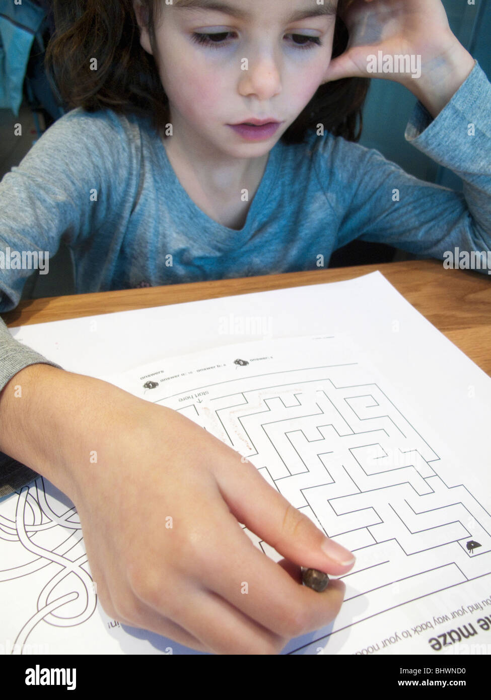 child solving a puzzle - Stock Image