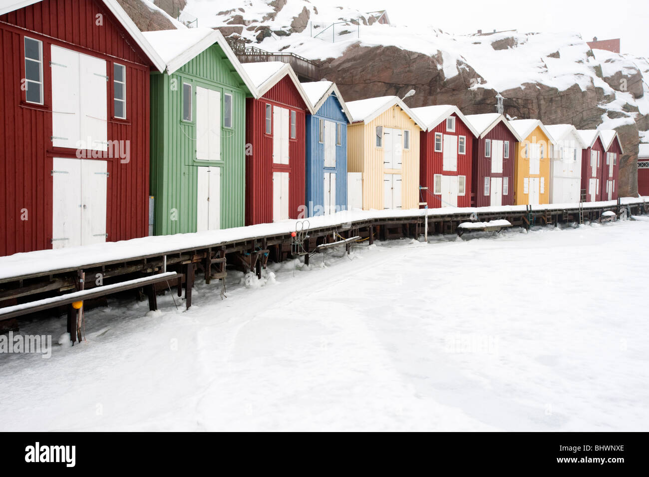 Smogen; Colourful wooden cabins in Traditional fishing village Smogen during winter after snow on Bohuslan coast - Stock Image