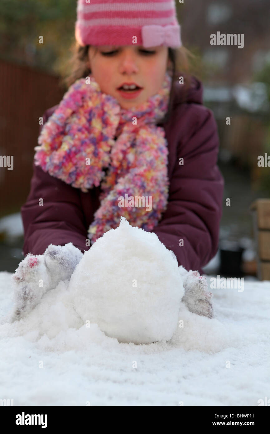 Child making snowball - Stock Image