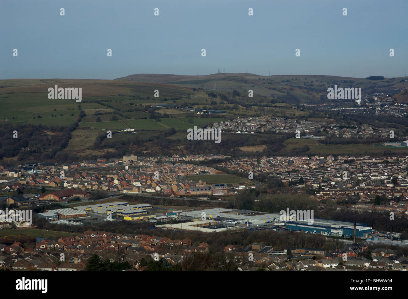Factories in Caerphilly, with housing and farmland in the distance - Stock Image