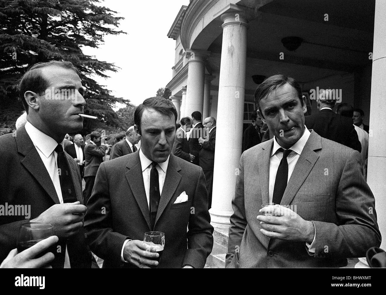 Jimmy Greave along with members of the England World Cup team meet Sean Connery during a visit to Pinewood film - Stock Image