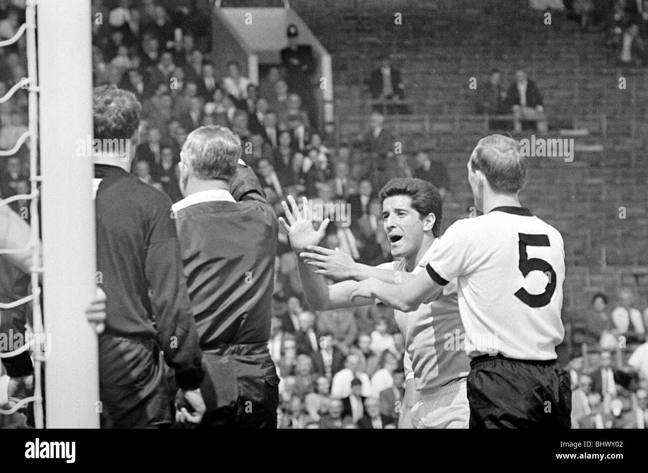 World Cup Quarter Finals West Germany versus Uruguay 24th July 1966 Uruguay's players argue with referee Mr - Stock Image