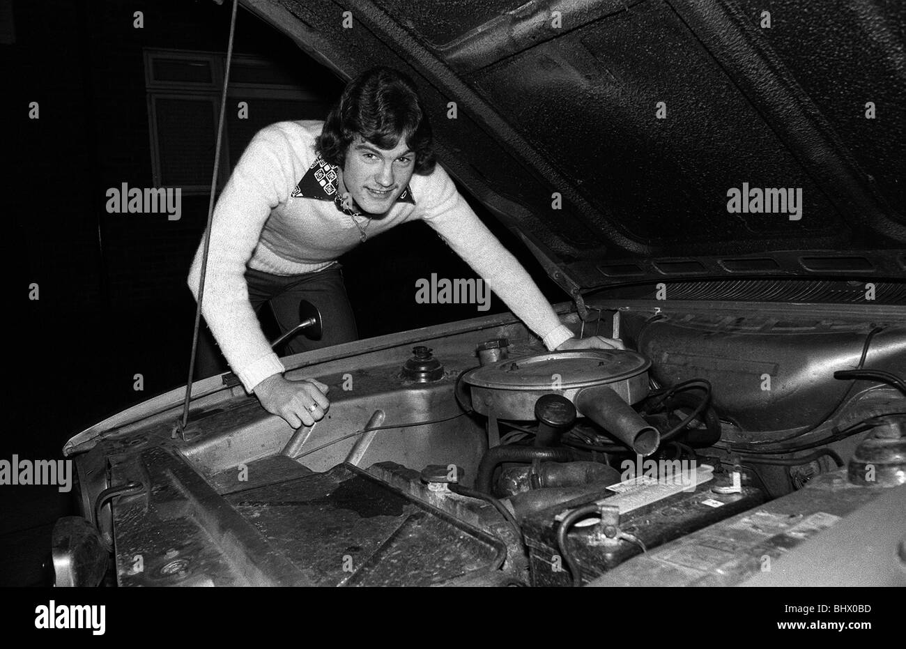 Footballer Glenn Hoddle at home with his car 1976 - Stock Image