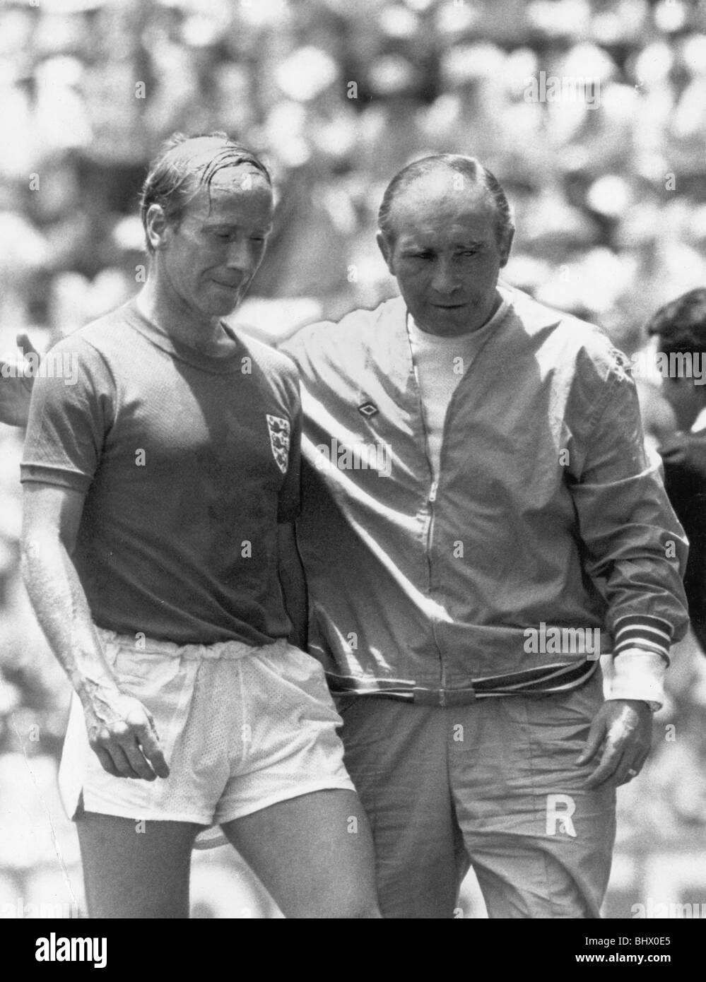 World Cup Quarter Final in Leon, Mexico. England 2 West Germany 3 after extra time Dejected Bobby Charlton leaves - Stock Image