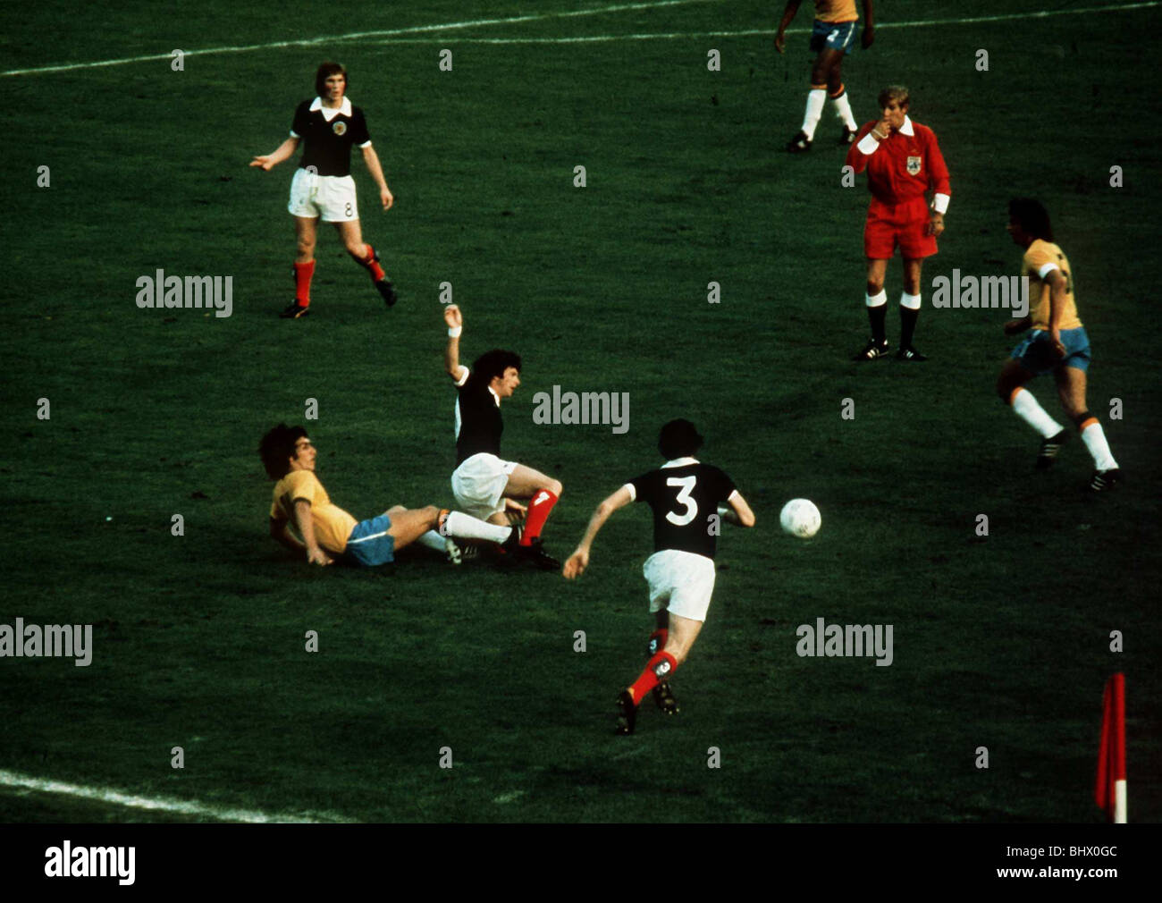 World Cup 1974 Scotland Brazil Morgan fouled referee Van Gemert blows whistle - Stock Image