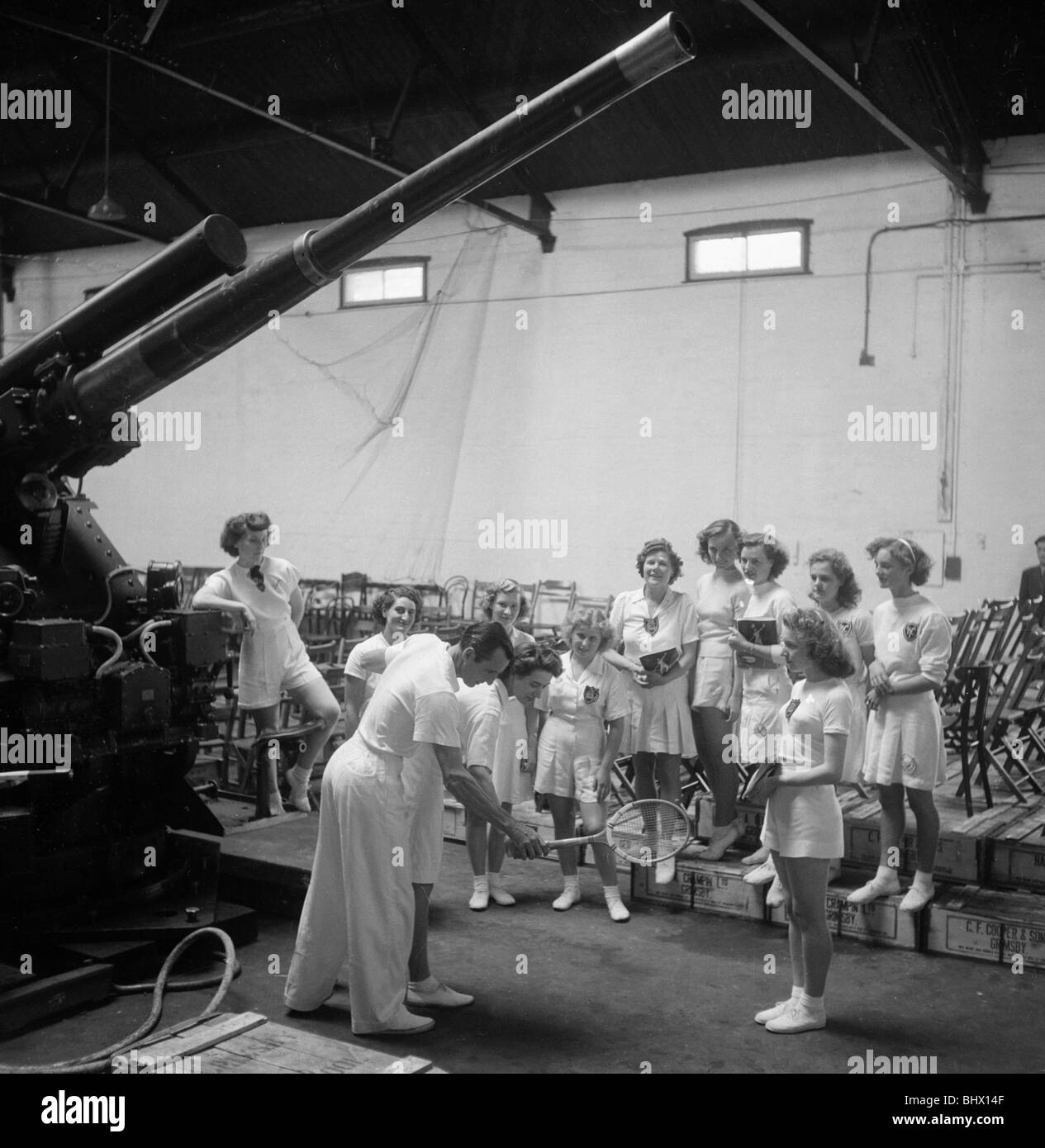 British tennis star Fred Perry demonstrates to members of the Yarrow Youth Club in Cleethorpes, Lancashire. Circa - Stock Image