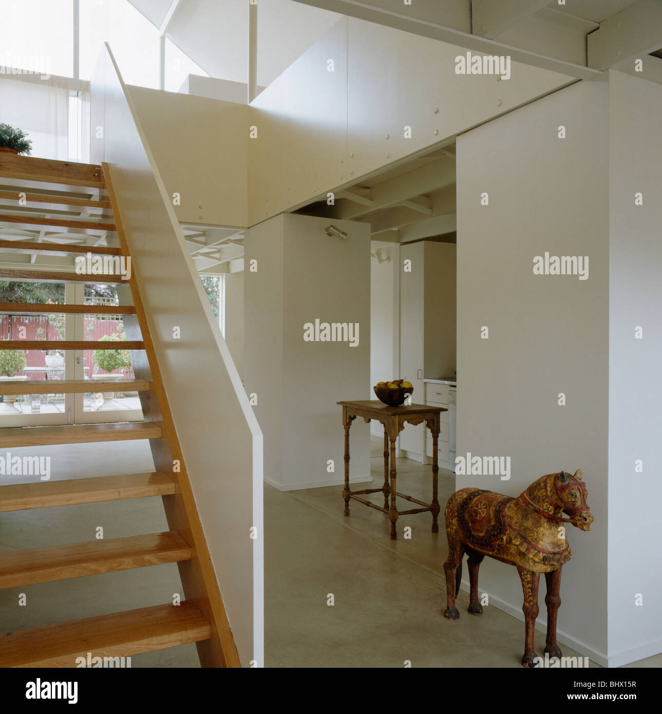 Open Tread Wooden Staircase In Modern Architectural White Hall With
