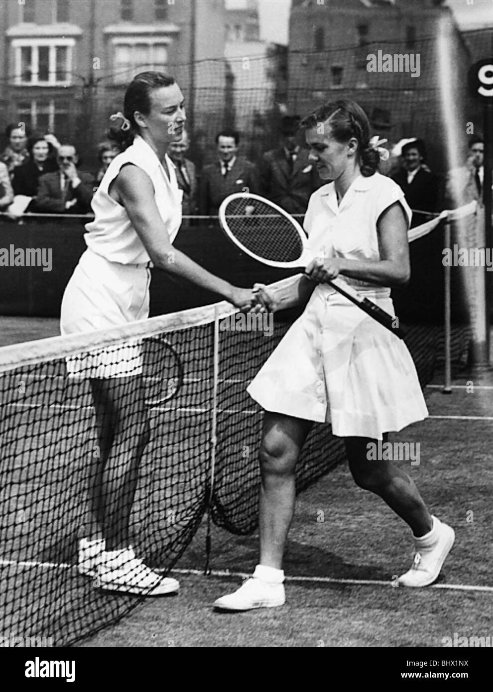 Miss Gussie Moran (left) being congratulated June 1949 after her win against Miss S Fry at Queens Club Gorgeous - Stock Image