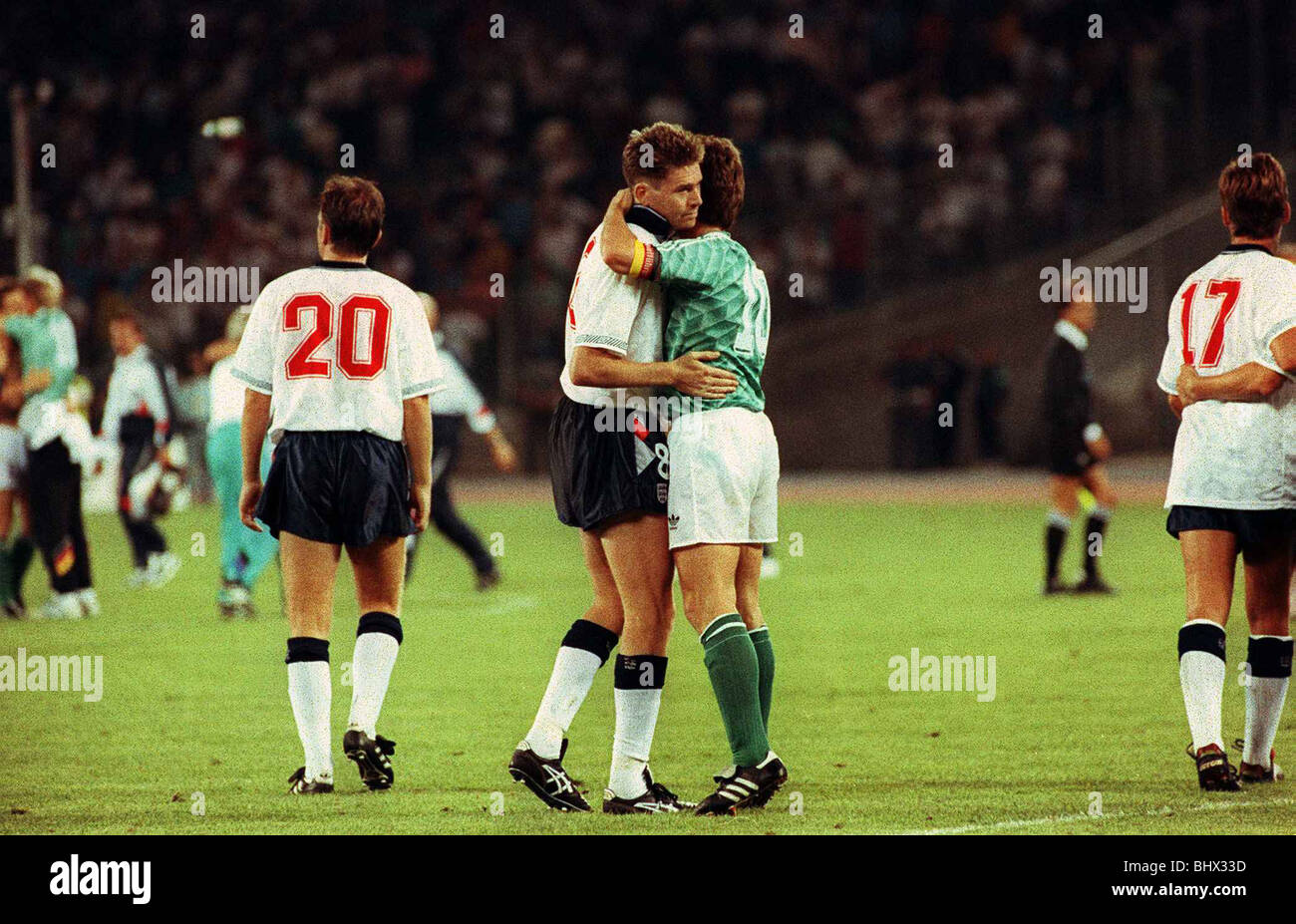World Cup 1990 Semi Final England 1 West Germany 1 Chris Waddle Football is consoled and embraced by Lothar Matthaus Stock Photo