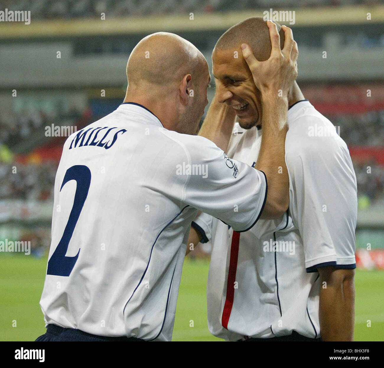 England 3 Denmark 0 June 2002, Mills grabs FerdinandÕs head after Ferdinand scores the 1st goal. - Stock Image