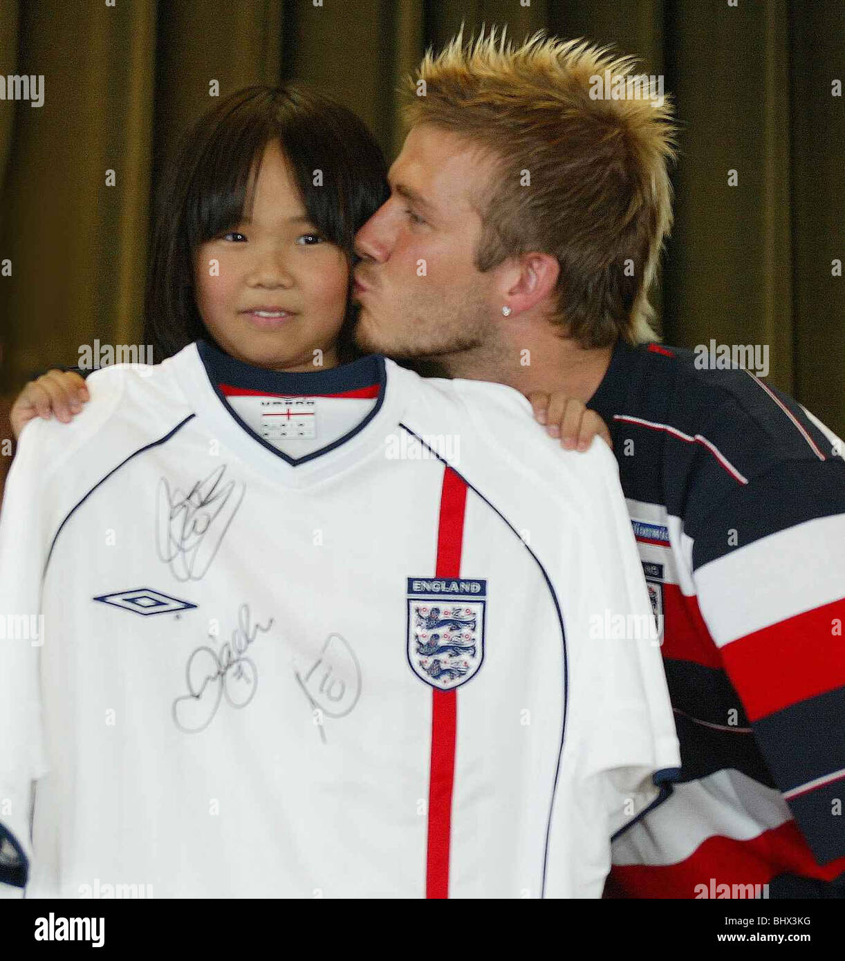 decee0a5910 England captain David Beckham June 2002 kisses Yuka Hirota (10 ) on a visit  to
