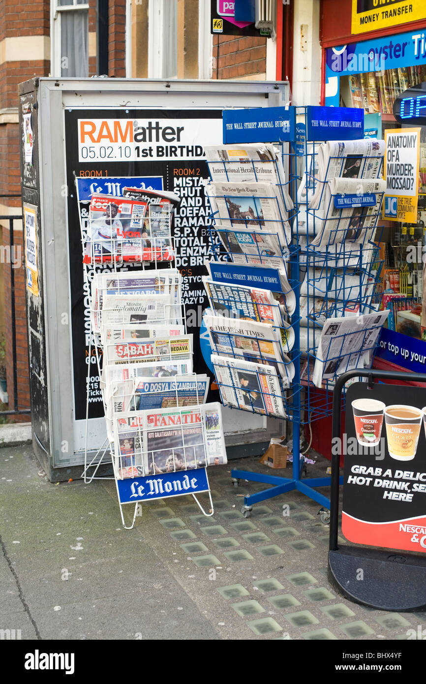 Newsagents shop international papers display, London, England, UK, Europe - Stock Image