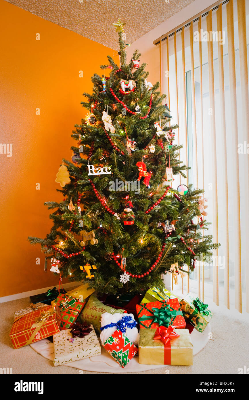 A Christmas Tree With Presentstered Below It
