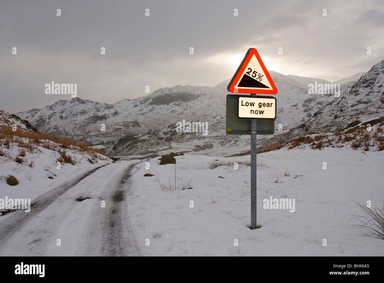 Road sign warning of 1-in-4 gradiant, Little Langdale, Lake District National Park, Cumbria, England UK - Stock Image