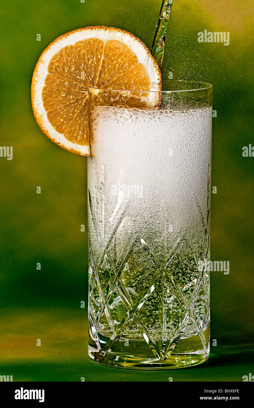 Pouring a gin and tonic - Stock Image