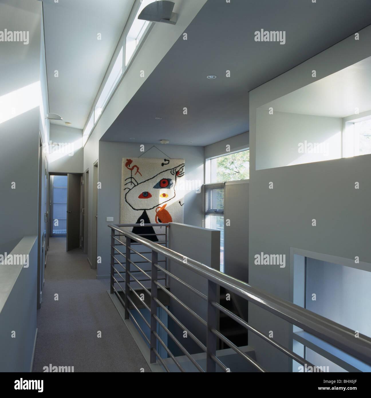 Metal banister on walkway landing in modern white hall Stock Photo