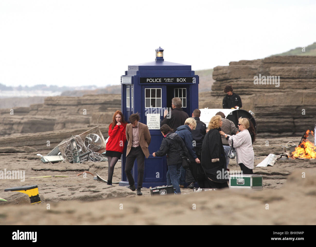 BBC Doctor Who filming with Matt Smith & Karen Gillan and TARDIS on the beach in the village of Southerndown - Stock Image