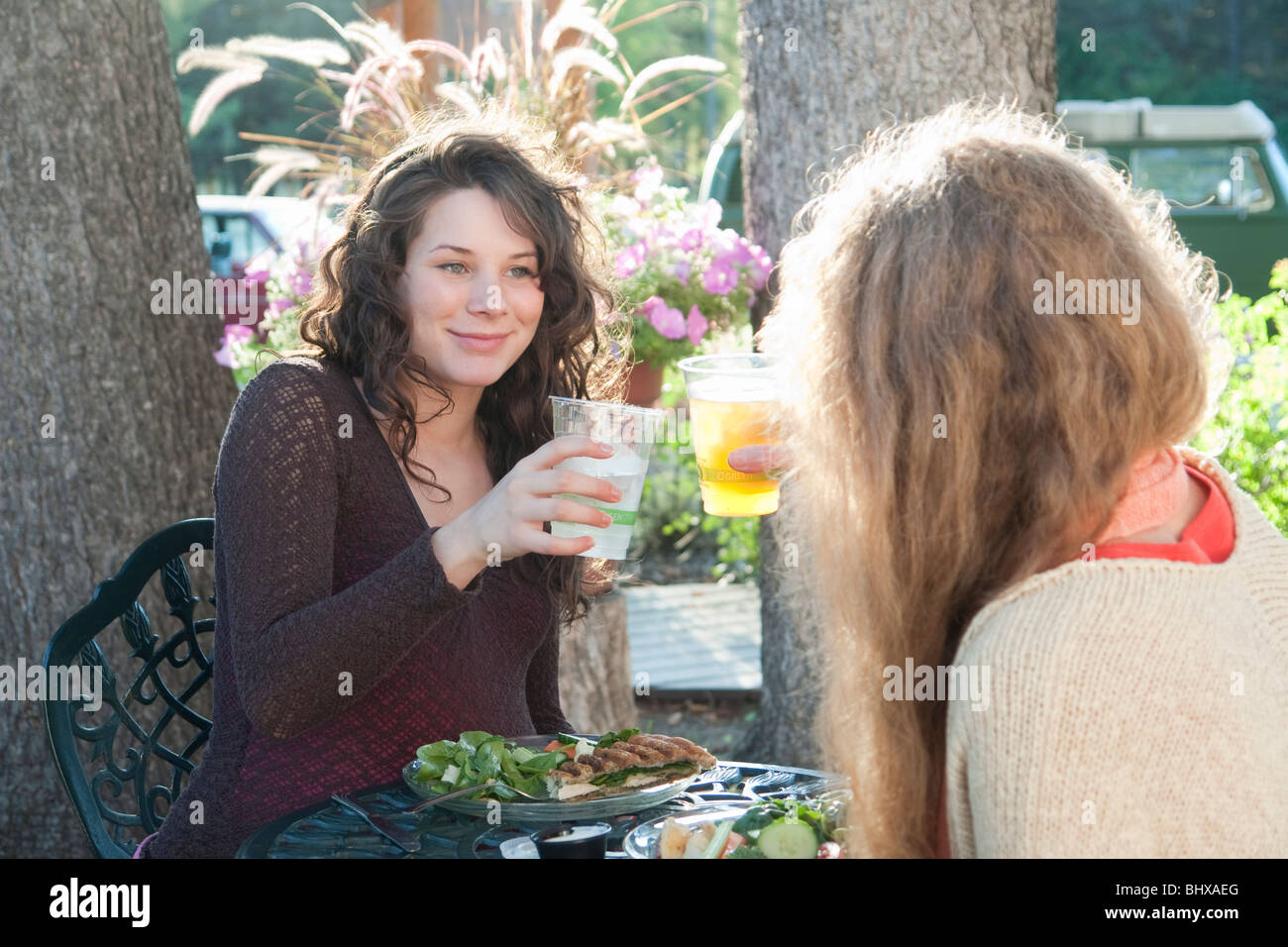 Pregnant Woman And Friend Eating At Outdoor Restaurant, Manitoba, Canada - Stock Image