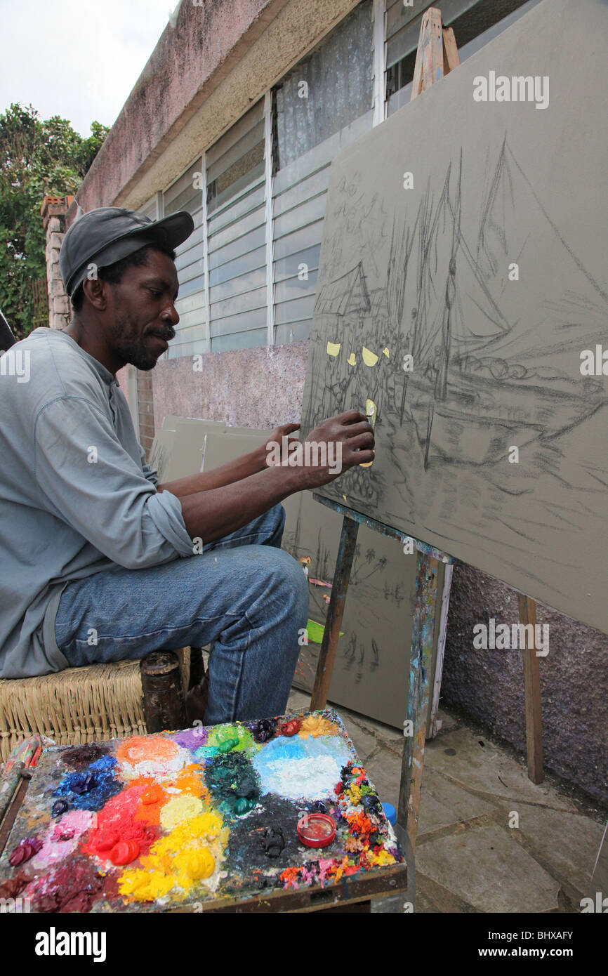 Haitian artist painting on canvas, Port au Prince, Haiti - Stock Image