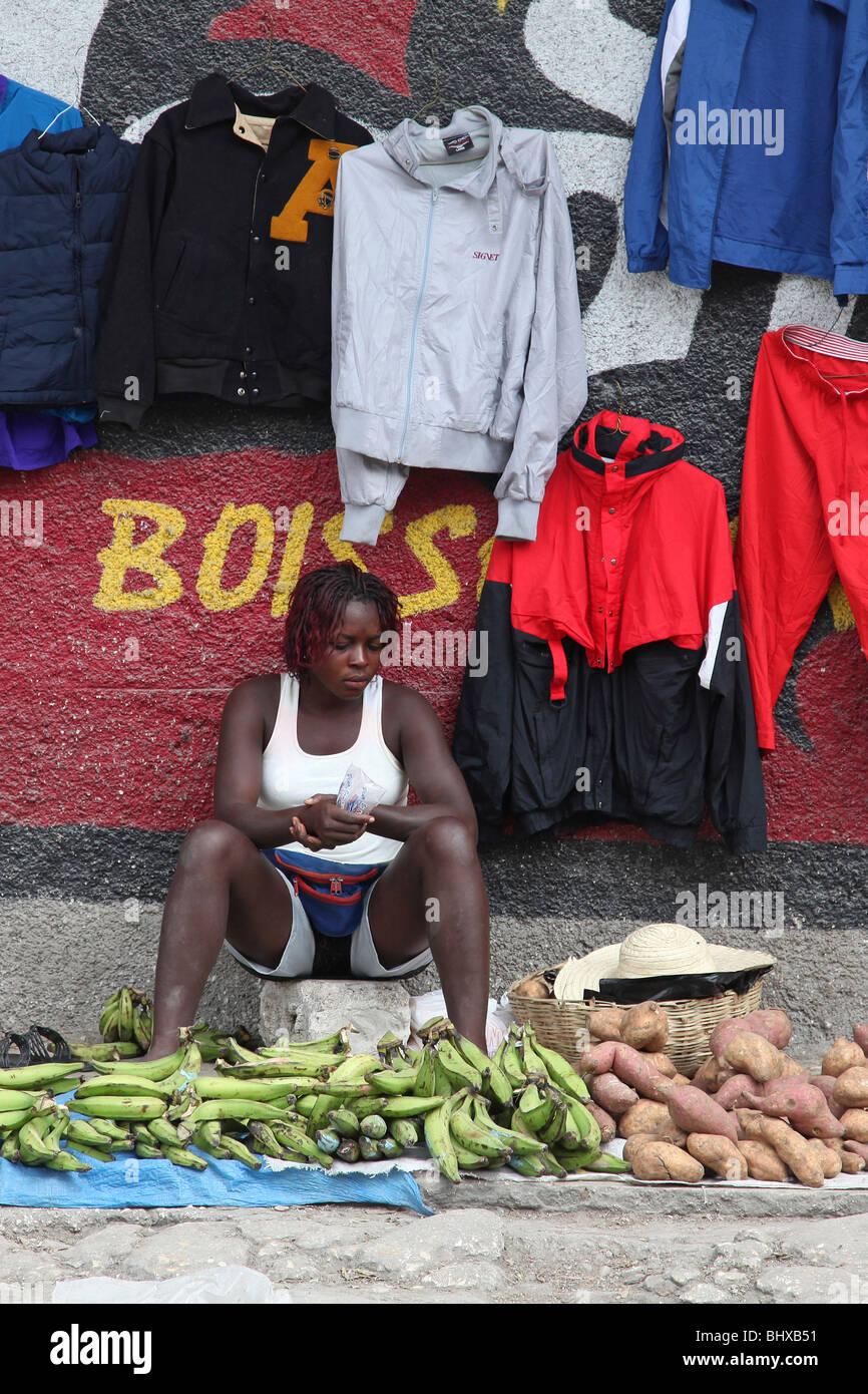 Woman selling vegetables at street market, Port au Prince, Haiti - Stock Image