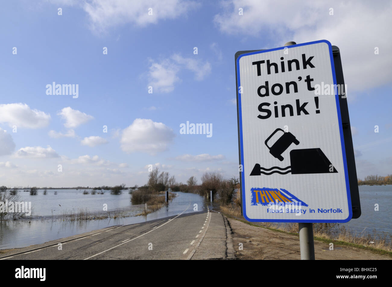 Think Don't Sink warning sign by a flooded A1101 at Welney Wash, Norfolk, England UK - Stock Image