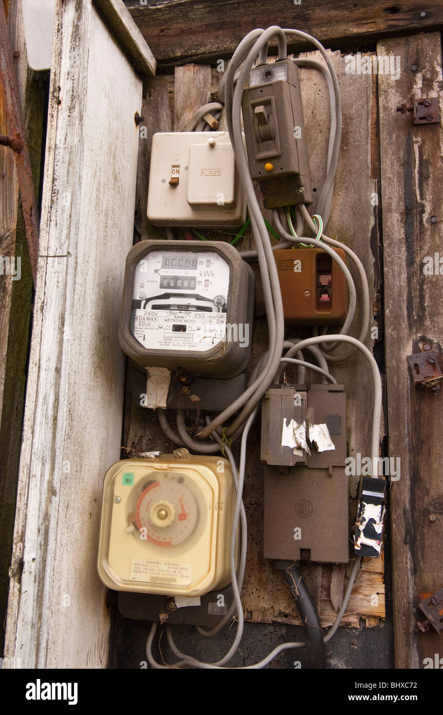An electric meter on a fishermans shed on the beach in Aldeburgh , Suffolk , England , Britain , Uk - Stock Image