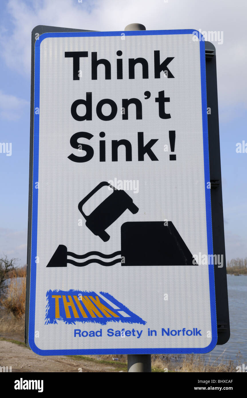 Think Don't Sink warning sign at a flooded A1101 at Welney Wash, Norfolk, England UK - Stock Image