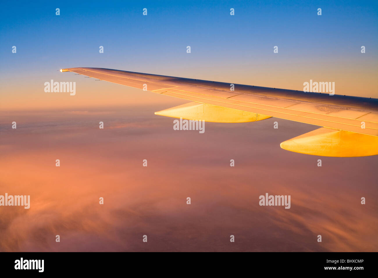 Boeing 747 aircraft wing at sunset Stock Photo