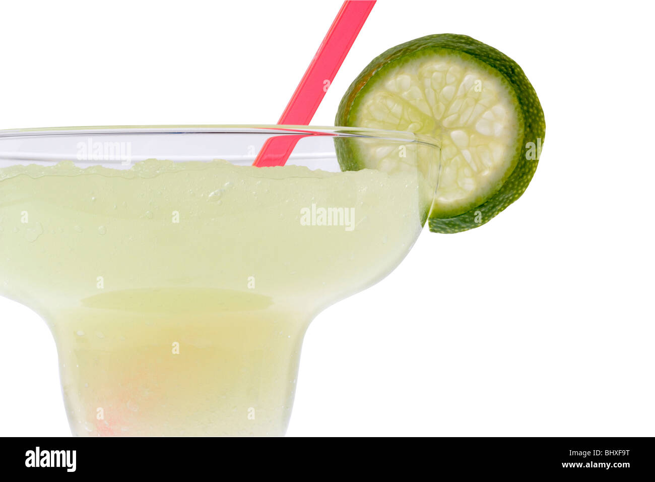 Margarita mixed drink with lime slice garnish on white background with clipping path - Stock Image